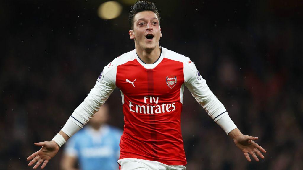Arsenal's star offensive player Mesut Özil celebrates a goal.