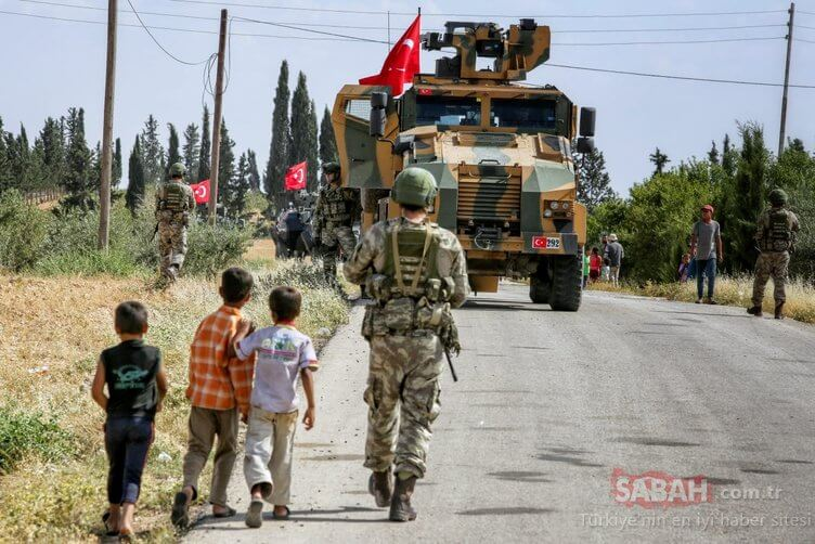 A Turkish soldier stands together with Syrian children.